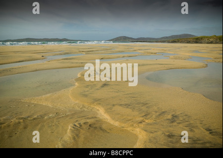 Outer Hebrides Island Harris beach at low tide sand sea and rocks coast shore line in Scotland - Stock Photo
