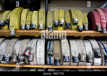 Fire hoses on storage shelf in a firehouse in West Haven Connecticut USA - Stock Photo