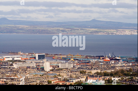 AN ELEVATED VIEW ACROSS EDINBURGH FROM ARTHURS SEAT OVER LEITH DOCKS WITH THE FIRTH OF FORTH AND  IN THE BACKGROUND - Stock Photo