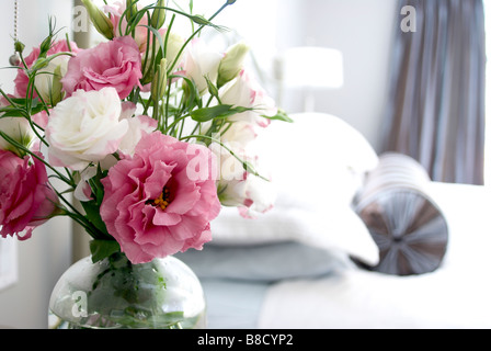 Pink  White Lisianthus Flowers Bedside Table - Stock Photo