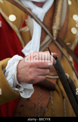 Close-up of a Grenadier ramming his firelock at the 2008 re-enactment of the Battle of Prestonpans - Stock Photo