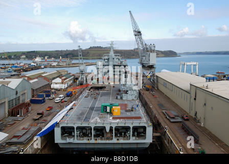 a ship from the royal auxiliary fleet undergoing repairs in dry dock at the shipyard in falmouth, cornwall, uk - Stock Photo