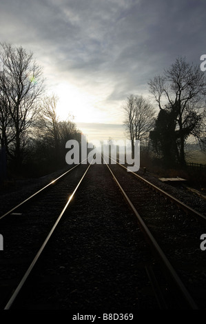 Converging railway lines, in dawn light, Womersley, Northern England - Stock Photo