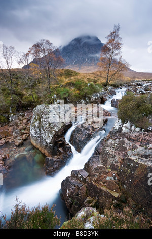 Waterfall  on the River Coupall with Buachaille Etive Mor in the background. - Stock Photo