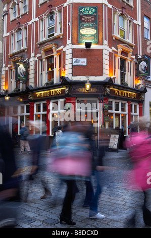 pub and blurry people in Covent Garden, London, UK - Stock Photo