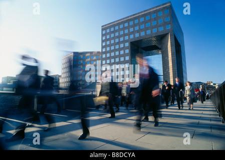 commuters on London Bridge, London, England, UK - Stock Photo