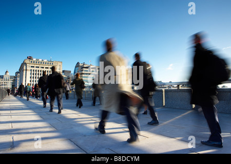 the trudge to work, commuters crossing London Bridge on the way to work, London, England, UK. (NR) - Stock Photo