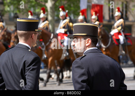 gendarmes (police) & French Cavalry (Presidential escort) on the Champs Elysses, Paris, France - Stock Photo