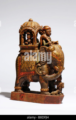An Antique Indian carved wood and painted caparisoned elephant - Stock Photo