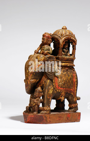 An Antique Indian carved wood and painted caparisoned elephant. - Stock Photo