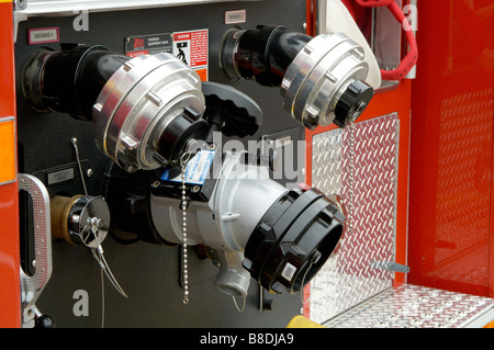 Water valves on a fire department vehicle on display during a fire muster parade - Stock Photo