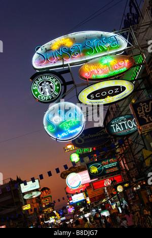 Neon bar signs along Khao San Road in Bangkok Thailand - Stock Photo