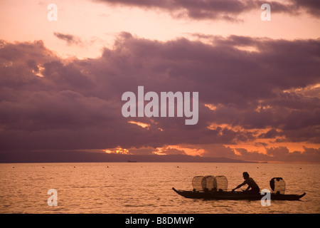 Fisherman at sunrise - Stock Photo