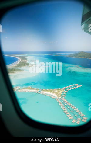 Airplane over society islands