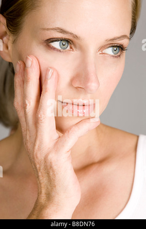 Young woman with aged hand - Stock Photo