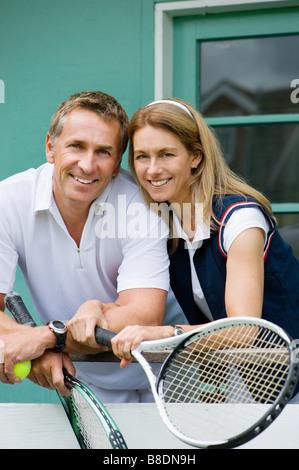 Mature tennis playing couple - Stock Photo