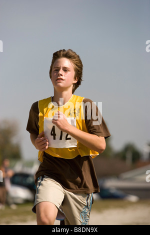 North America Canada Ontario boy running in race - Stock Photo