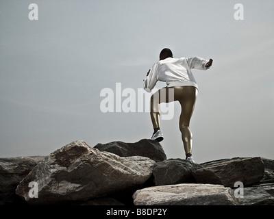 Male athlete on rocks - Stock Photo
