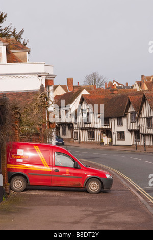 A view up the high street in Lavenham,Suffolk,Uk with a royal mail postvan on delivery - Stock Photo