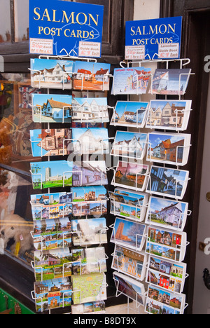 Postcards for sale on a postcard stand outside a shop store in Lavenham,Suffolk,Uk - Stock Photo