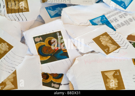 A pile of used British stamps - Stock Photo