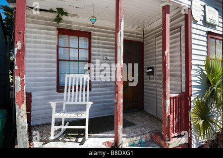 Dilapidated old house on Whitehead Street in the historic district, Key West, Florida Keys, USA - Stock Photo