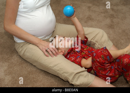 Playing with Mom - Stock Photo