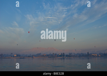 Balloons floating at dawn above the West Bank, Luxor, Egypt - Stock Photo
