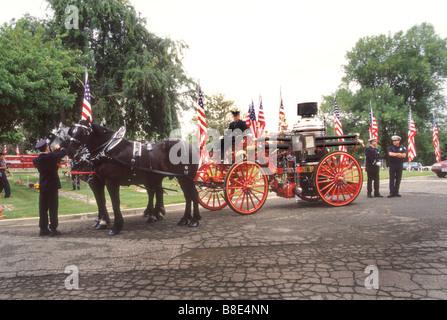 Historical horse drawn fire wagon participates in memorial events for Orange County, California - Stock Photo