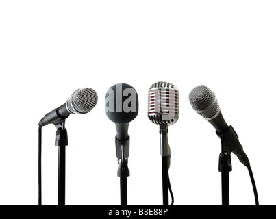 Four Microphones on Stand - Stock Photo