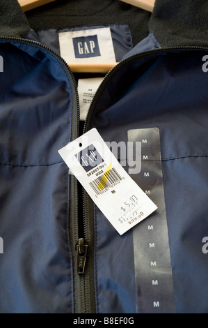 Gap item showing multiple markdowns on it's price tag which illustrates difficult economic times and a slowdown - Stock Photo