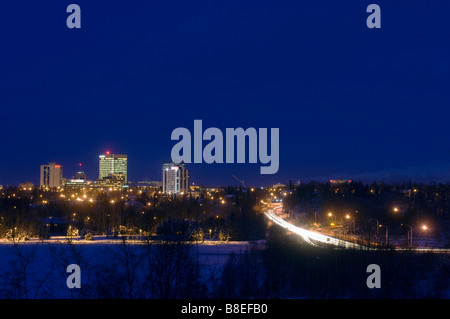 Skyline view of Anchorage, Alaska at night during Winter - Stock Photo