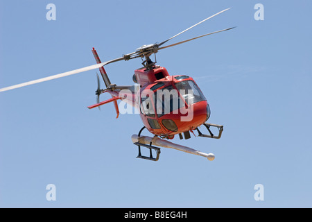 helicopter aerial work survey mining AS350 astar eurocopter - Stock Photo
