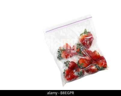 Clear Plastic Bag of Smashed Red Strawberries - Stock Photo