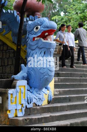 Painted blue dragon steps at the base of the giant Buddha, Long Son Pagoda, Nha Trang, Vietnam - Stock Photo