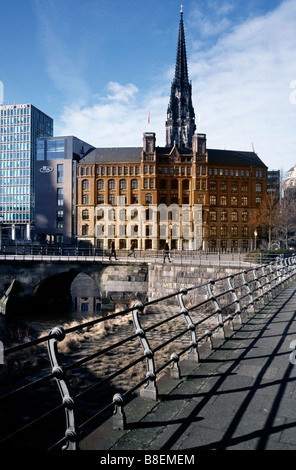 Feb 18, 2009 - View of Laeiszhof with the spire of Saint Nikolai church at the back and Zollenbrücke in Hamburg. - Stock Photo
