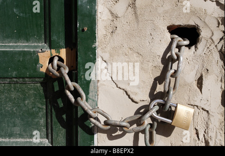 Closed door with chain and padlock - Stock Photo
