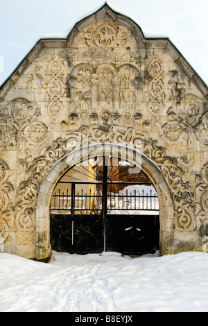 Old monasterium gateway closed in winter time. - Stock Photo