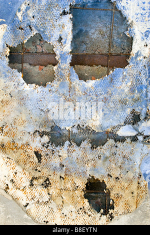 Room ceiling peeling and forming halloween like mask. - Stock Photo