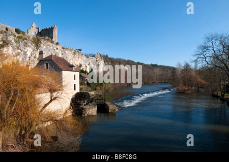 Ruined chateau / castle, water mill and river weir, Angles-sur-l'Anglin, Vienne, France. - Stock Photo