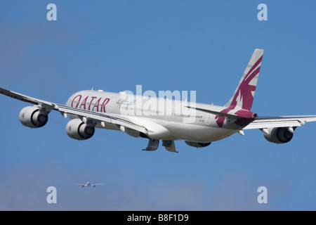 Qatar Airways Airbus A340-642 departure at London Heathrow Airport, United Kingdom - Stock Photo