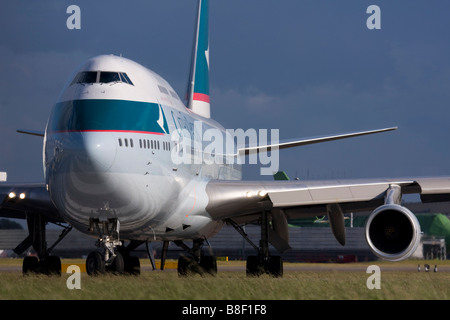 Cathay Pacific Airways Boeing 747-467 taxiing for departure at London Heathrow airport UK - Stock Photo