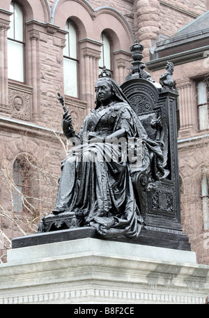 Queen Victoria Statue, seated on throne, at Queen's Park in Toronto - Stock Photo