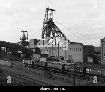 The pithead of Boldon Colliery coal mine with NCB coal trucks in the foreground, north east England, UK - Stock Photo