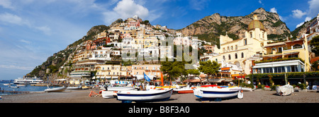 Scenic view of Positano beach with fishing boat and the cliff houses of Positano, Amalfi Caost, Italy - Stock Photo