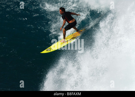 Big Wave Surfing at Honolua Bay on the Hawaiian Island of Maui - Stock Photo
