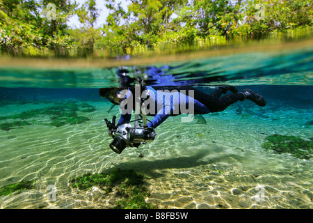 Underwater photographer explores the underwater landscape floating down Olho D Agua river Bonito Mato Grosso do - Stock Photo