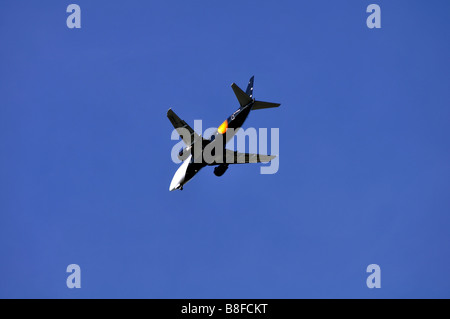 Titan Airways Boeing 737 aircraft seen from below - Stock Photo