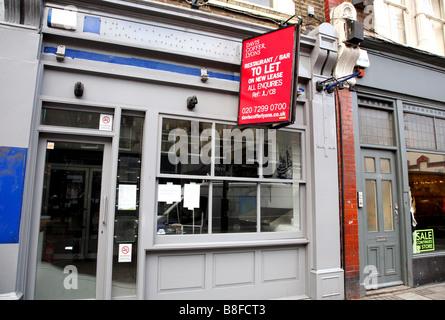 Closed down restaurant premises in Islington, London - Stock Photo
