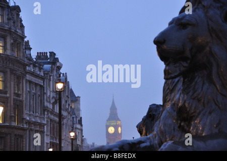 St Stephens Tower (Big Ben) from Trafalgar Square at dusk with Lion, London, England. - Stock Photo